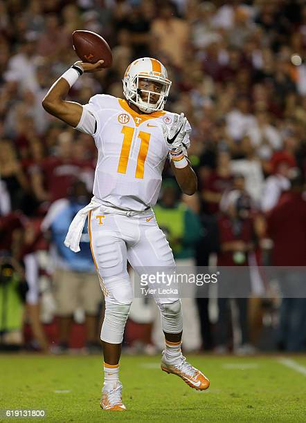 Joshua Dobbs of the Tennessee Volunteers drops back to pass against the South Carolina Gamecocks during their game at WilliamsBrice Stadium on...