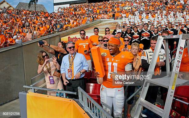 Joshua Dobbs of the Tennessee Volunteers joins the band in the stands to celebrate a win over Northwestern Wildcats in the Outback Bowl at Raymond...
