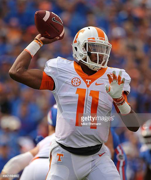 Joshua Dobbs of the Tennessee Volunteers passes during a game against the Florida Gators at Ben Hill Griffin Stadium on September 26 2015 in...
