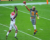 Joshua Dobbs of the Tennessee Volunteers passes over Quincy Mauger of the Georgia Bulldogs on October 10 2015 at Neyland Stadium in Knoxville...