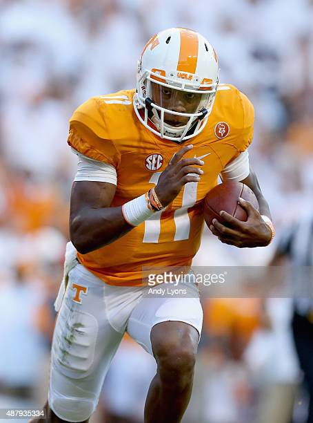 Joshua Dobbs of the Tennessee Volunteers runs for a touchdown against the Oklahoma Sooners during the game at Neyland Stadium on September 12 2015 in...