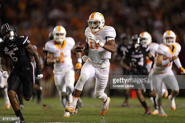 Joshua Dobbs of the Tennessee Volunteers runs with the ball against the South Carolina Gamecocks during their game at WilliamsBrice Stadium on...