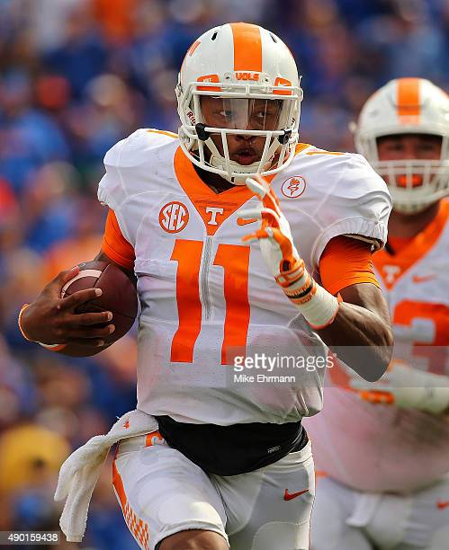 Joshua Dobbs of the Tennessee Volunteers rushes for a touchdown during a game against the Florida Gators at Ben Hill Griffin Stadium on September 26...