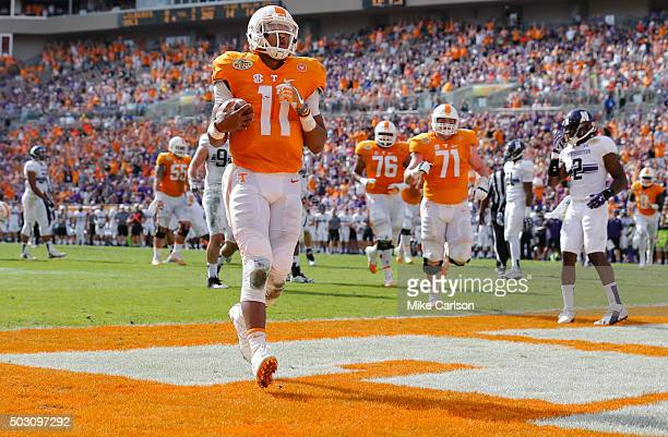 Joshua Dobbs of the Tennessee Volunteers scores a touchdown against the Northwestern Wildcats during the first half of the Outback Bowl at Raymond...