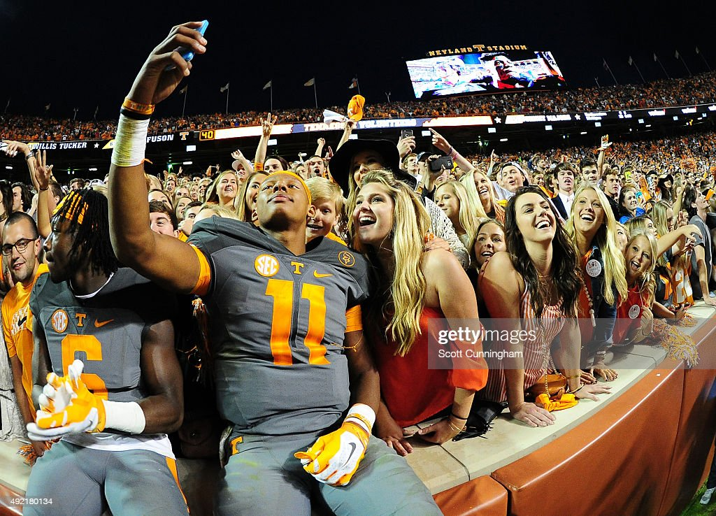 Joshua Dobbs of the Tennessee Volunteers takes a selfie with fans after the game against the Georgia Bulldogs on October 10 2015 at Neyland Stadium...