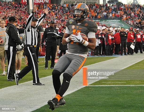 Joshua Dobbs of the University of Tennessee Volunteers rushes for a touchdown against the Nebraska Cornhuskers during the first half of the Franklin...