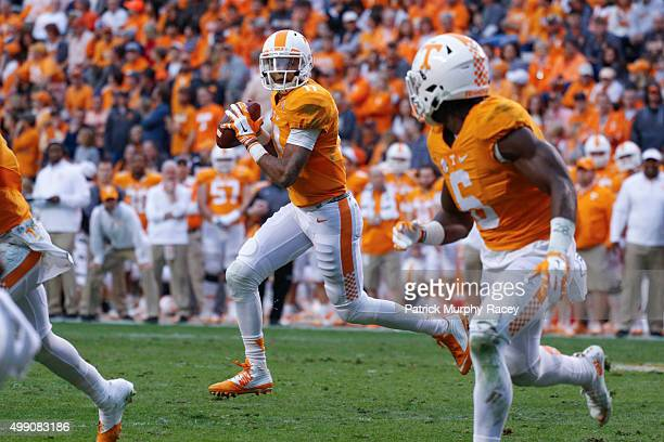 Joshua Dobbs the Tennessee Volunteers looks for teammate Alvin Kamara against the Vanderbilt Commodores in a game at Neyland Stadium on November 28...