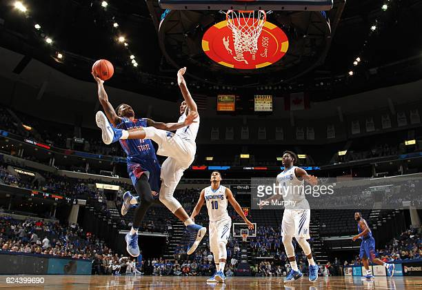 Joshua Floyd of the Savannah State Tigers drives to the basket for a layup against Craig Randall II of the Memphis Tigers on November 19 2016 at...