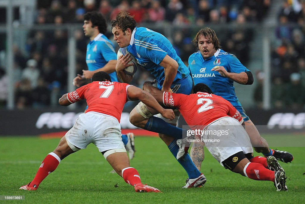 Joshua Furno of Italy is tackled by Elvis Taione (R) of Tonga during the international test match between Italy and Tonga at Mario Rigamonti Stadium on November 10, 2012 in Brescia, Italy.