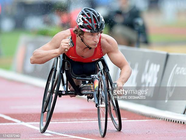 US Joshua George crosses the finish line to win the Men's 800 m T53 on July 22 2013 during the IPC Athletics World Championships of Lyon at the Rhône...