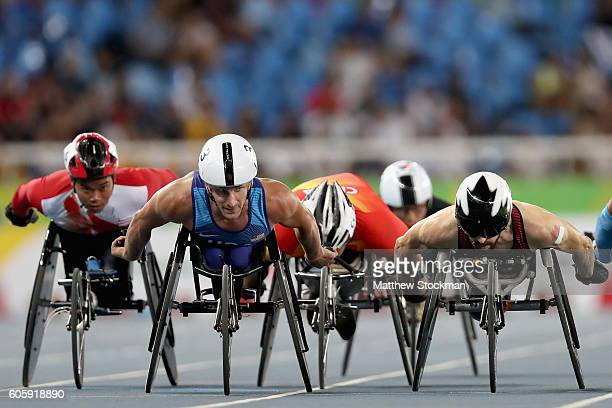 Joshua George of the United States and Brent Lakatos of Canada lead the pack into the first turn of the second lap of the men's 800 T53 final during...