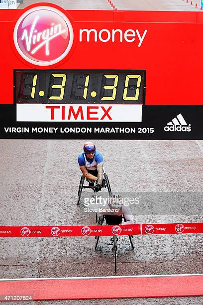 Joshua George of the United States crosses the the finish line ahead of David Weir of Great Britain to win the Men's Wheelchair Virgin Money London...