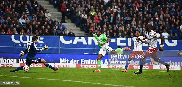 Joshua Guilavogui of Wolfsburg scores the fisrt goal during the Bundesliga match between Hamburger SV and VfL Wolfsburg at Imtech Arena on April 11...