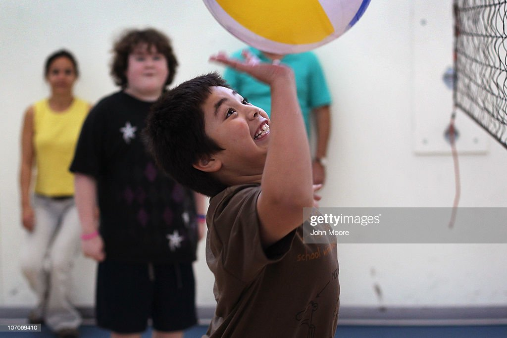 Joshua Guillen, 10, participates in group excercise during the Shapedown program for overweight adolescents and children on November 13, 2010 in Aurora, Colorado. The 10-week family-centered program held by the Denver area Children's Hospital teaches youth and their parents ways to lead a healthier more active lifestyle, as a longer lasting weight-loss alternative to dieting. Nationally, some 15 percent of children are overweight or obese, as are some 60 percent of adults.