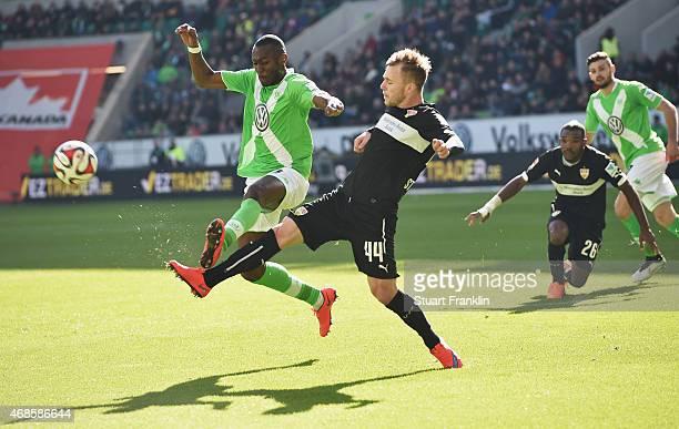 Joshua Guilvogui of Wolfsburg is challenged by Alexandru Maxim of Stuttgart during the Bundesliga match between VfL Wolfsburg and VfB Stuttgart at...