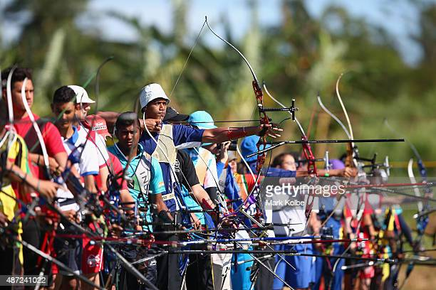 Joshua Hans Walter of Samoa competes in the archery qualification round at the Tuanaimato Sports Facility on day two of the Samoa 2015 Commonwealth...