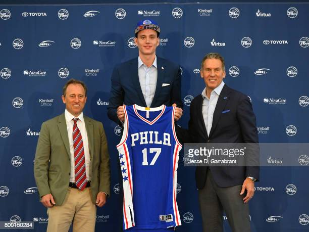 Joshua Harris and Bryan Colangelo of the Philadelphia 76ers introduce their new draftee Anzejs Pasecniks at the Sixers Training Complex on June 23...