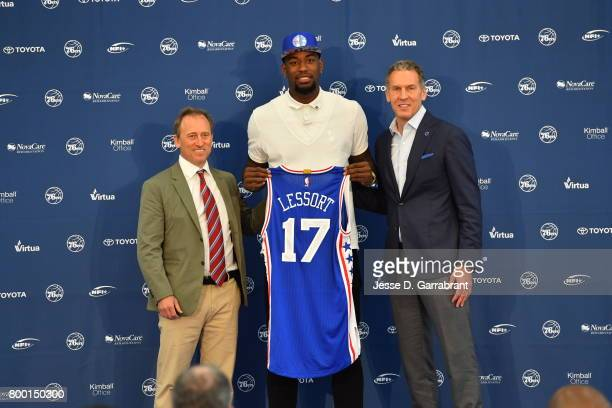 Joshua Harris and Bryan Colangelo of the Philadelphia 76ers introduce their new draftee Mathias Lessort at the Sixers Training Complex on June 23...