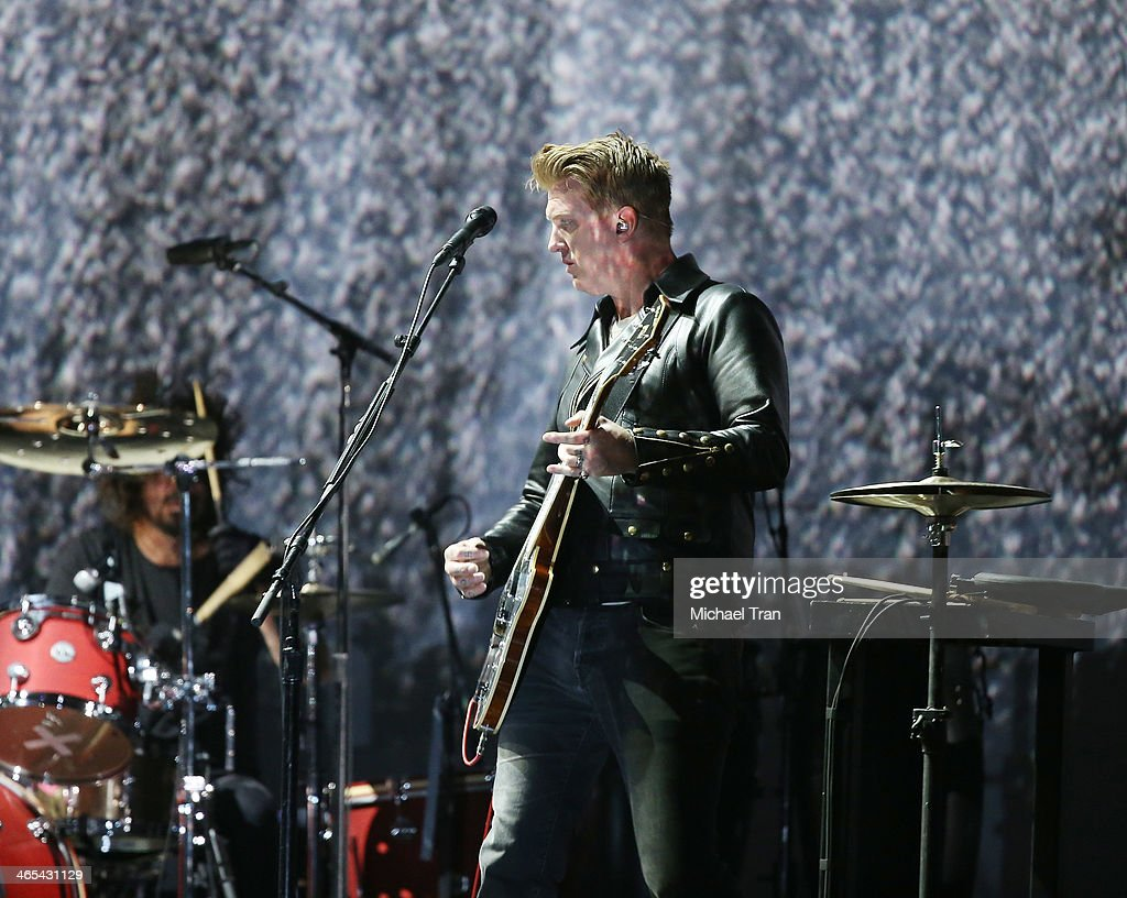Joshua Homme of Queens of the Stone Age performs onstage during the 56th GRAMMY Awards held at Staples Center on January 26, 2014 in Los Angeles, California.