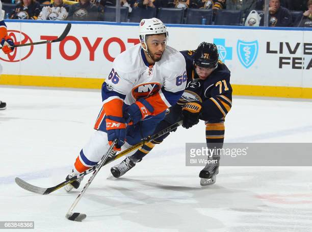 Joshua HoSang of the New York Islanders skates against Evan Rodrigues of the Buffalo Sabres during an NHL game at the KeyBank Center on April 2 2017...