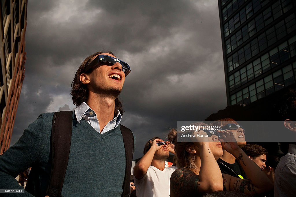 Joshua Howes, from New York, wears special goggles to observe the Transit of Venus from the High Line park on June 5, 2012 in New York City. The Transit of Venus involves the planet Venus crossing in front of the sun. The next pair of events will not happen again until the year 2117 and 2125.