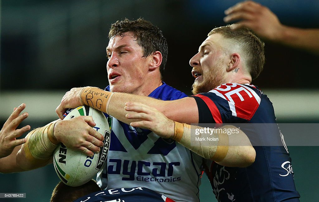 Joshua Jackson of the Bulldogs is tackled during the round 17 NRL match between the Sydney Roosters and the Canterbury Bulldogs at Allianz Stadium on June 30, 2016 in Sydney, Australia.