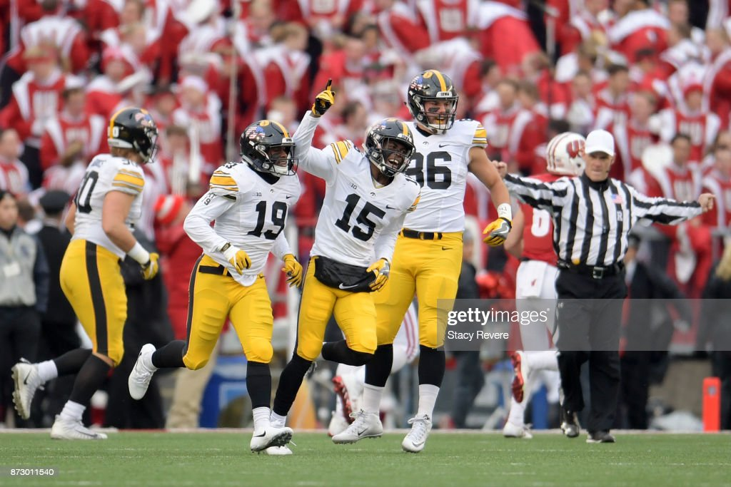Joshua Jackson #15 of the Iowa Hawkeyes celebrates an interception returned for a touchdown against the Wisconsin Badgers during the first quarter of a game at Camp Randall Stadium on November 11, 2017 in Madison, Wisconsin.