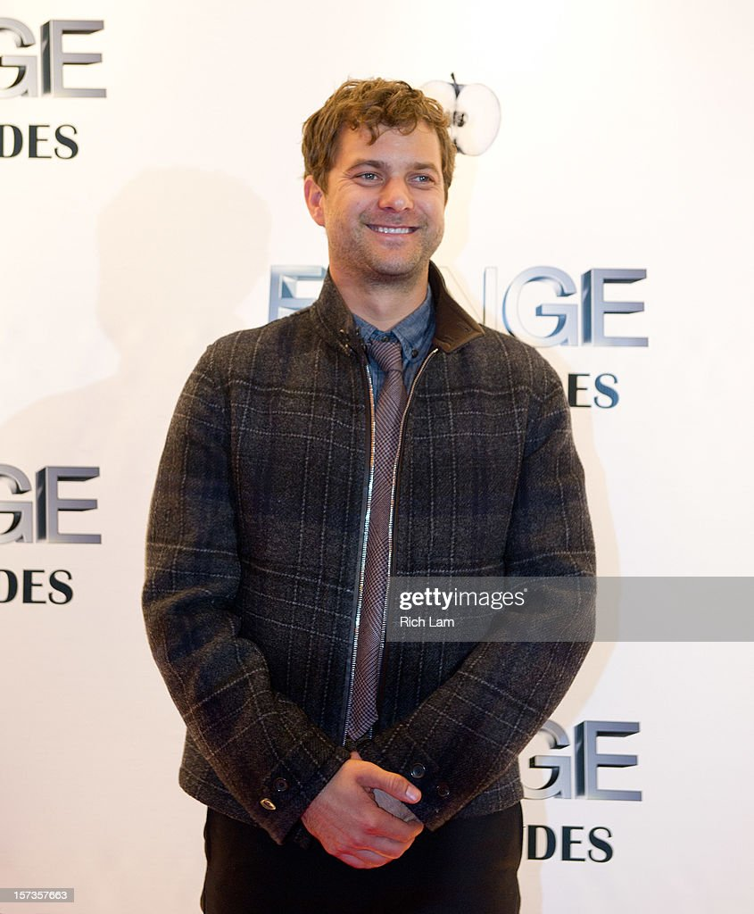 <a gi-track='captionPersonalityLinkClicked' href=/galleries/search?phrase=Joshua+Jackson+-+Actor&family=editorial&specificpeople=208160 ng-click='$event.stopPropagation()'>Joshua Jackson</a> poses for photos on the red carpet while attending 'Fringe' celebrates 100 episodes and final season at Fairmont Pacific Rim on December 1, 2012 in Vancouver, Canada.