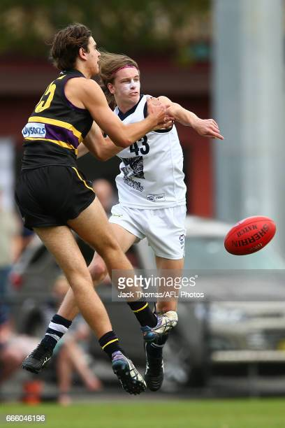 Joshua Jaska of the Geelong Falcons and Floyd Bollinghaus of the Murray Bushrangers compete for the ball during the round three TAC Cup match between...