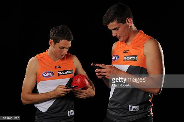 Joshua Kelly and Thomas Boyd seen on their phones after being drafted to Greater Western Sydney during the 2013 NAB AFL Draft on November 21 2013 on...