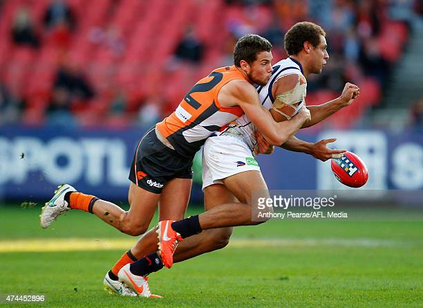 Joshua Kelly of the Giants tackles Cam EllisYolmen of the Crows during the round eight AFL match between the Greater Western Sydney Giants and the...