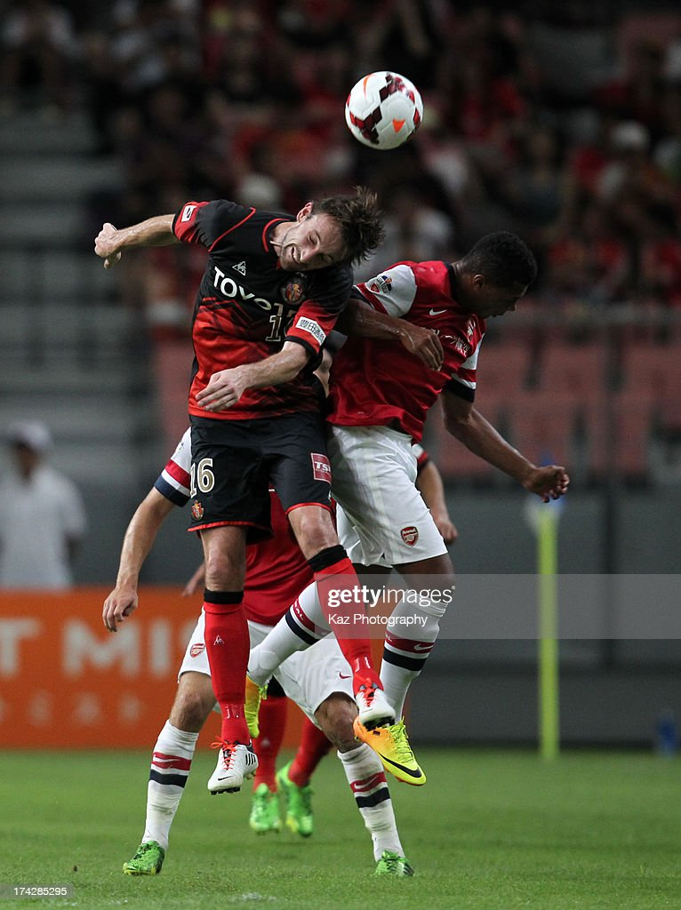 Joshua Kennedy of Nagoya Grampus and <a gi-track='captionPersonalityLinkClicked' href=/galleries/search?phrase=Serge+Gnabry&family=editorial&specificpeople=7257697 ng-click='$event.stopPropagation()'>Serge Gnabry</a> of Arsenal compete for the ball during the pre-season friendly match between Nagoya Grampus and Arsenal at Toyota Stadium on July 22, 2013 in Toyota, Aichi, Japan.