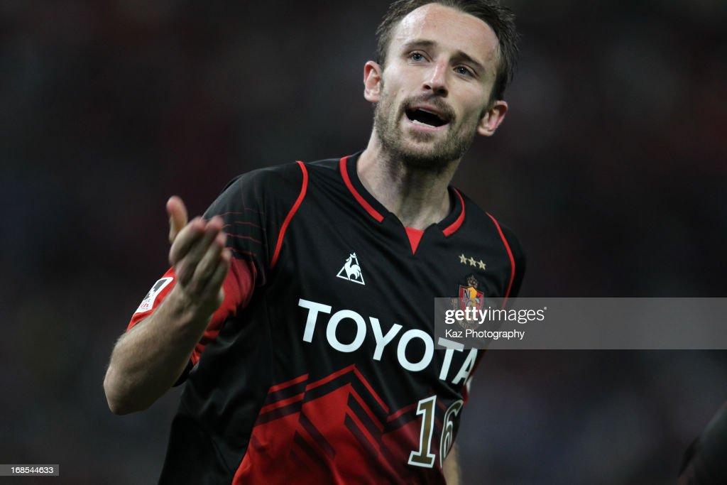 Joshua Kennedy of Nagoya Grampus celebrates scoring his team's first goal during the JLeague match between Nagoya Grampus and Yokohama FMarinos at...