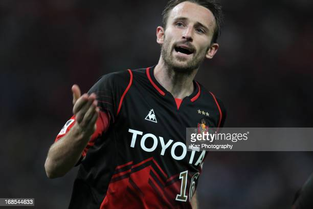 Joshua Kennedy of Nagoya Grampus celebrates scoring his team's first goal during the JLeague match between Nagoya Grampus and Yokohama FMarinos at...