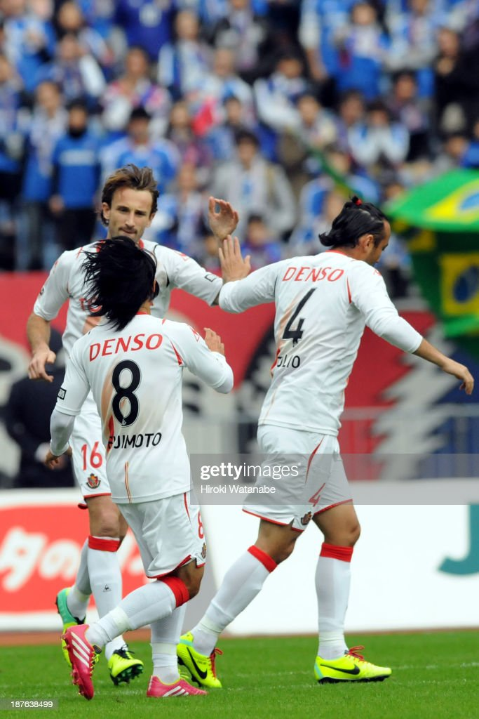 Joshua Kennedy (L) of Nagoya Grampus celebrates scoring his team's first goal with his team mates Jungo Fujimoto (C) and Marcus Tulio Tanaka during the J.League match between Nagoya Grampus and Yokohama F.Marinos at Nissan Stadium on November 10, 2013 in Yokohama, Kanagawa, Japan.