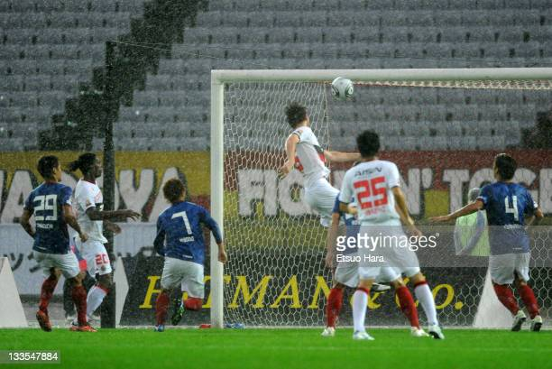 Joshua Kennedy of Nagoya Grampus scores the second goal during the JLeague match between Yokohama F Marinos and Nagoya Grampus at Nissan Stadium on...