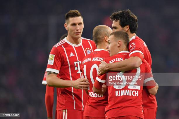 Joshua Kimmich and Mats Hummels of FC Bayern Muenchen celebrate their teams second goal during the Bundesliga match between FC Bayern Muenchen and FC...