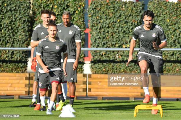 Joshua Kimmich and Mats Hummels of FC Bayern Muenchen run during a Bayern Muenchen training session ahead of the UEFA Champions League Group B match...