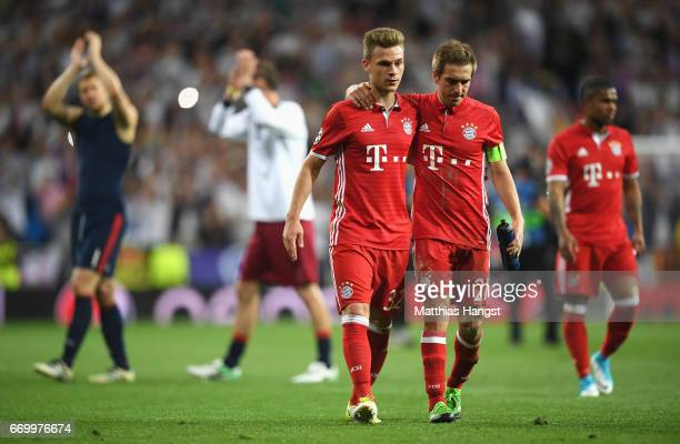 Joshua Kimmich and Philipp Lahm of Bayern Muenchen look dejected following the UEFA Champions League Quarter Final second leg match between Real...