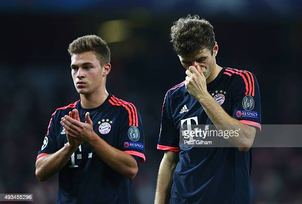 Joshua Kimmich and Thomas Mueller of Bayern Munich look dejected in defeat after the UEFA Champions League Group F match between Arsenal FC and FC...