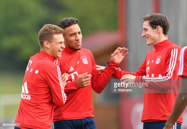 Joshua Kimmich Corentin Tolisso and Sebastian Rudy of FC Bayern Muenchen share a laugh during a training session at Saebener Strasse training ground...
