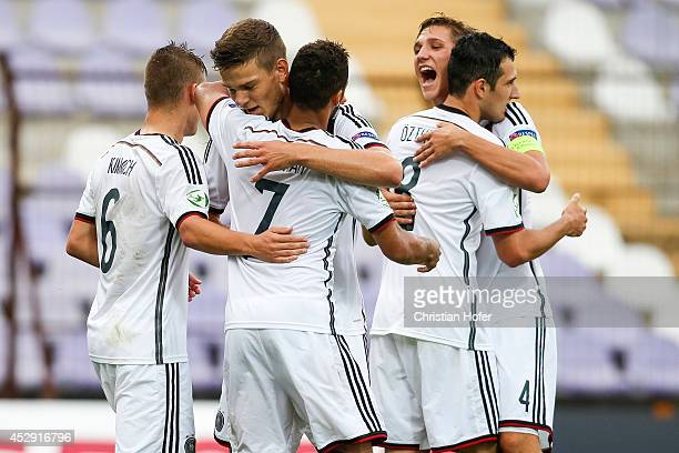 Joshua Kimmich Hany Mukhtar Anthony Syhre Levin Mete Oeztunali and Niklas Stark of Germany celebrate after scoring during the UEFA Under19 European...