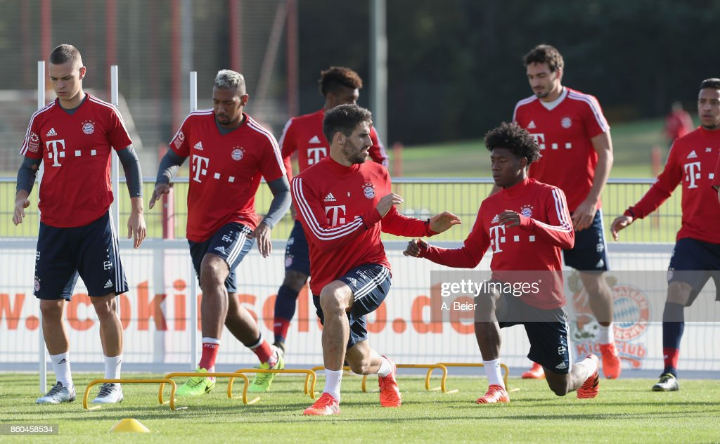 Joshua Kimmich, Jerome Boateng, Kingsley Coman, Javi Martinez, David Alaba, Mats Hummels and Corentin Tolisso (L-R) of FC Bayern Muenchen warm up during a training session at the Saebener Strasse training ground on October 12, 2017 in Munich, Germany.