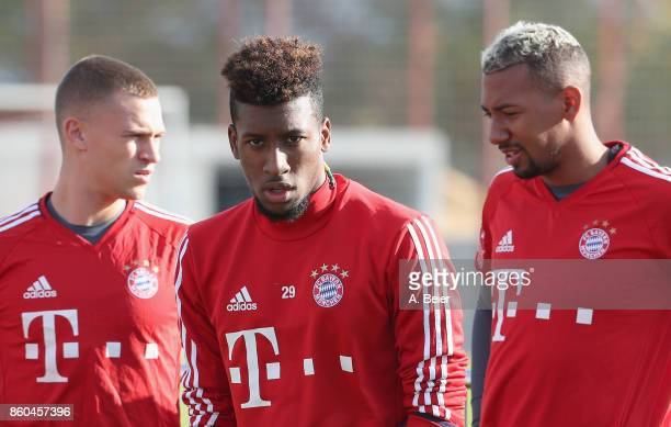 Joshua Kimmich Kingsley Coman and Jerome Boateng of FC Bayern Muenchen are pictured during a training session at the Saebener Strasse training ground...
