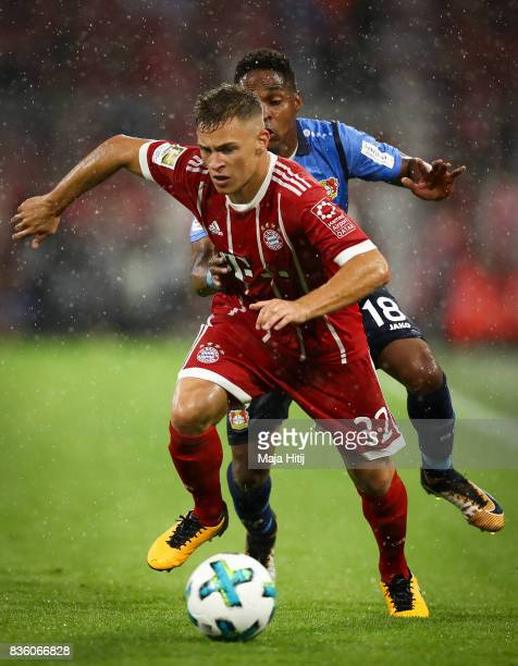 Joshua Kimmich of Bayern and Wendell of Leverkusen battle for the ball during the Bundesliga match between FC Bayern Muenchen and Bayer 04 Leverkusen...