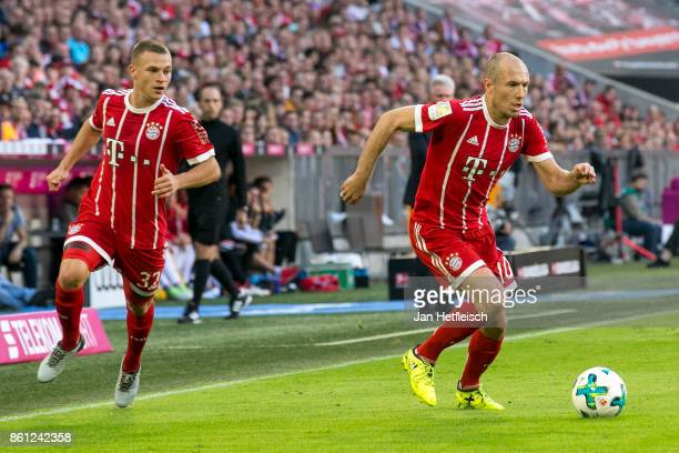 Joshua Kimmich of Bayern Muenchen and Arjen Robben of Bayern Muenchen during the Bundesliga match between FC Bayern Muenchen and SportClub Freiburg...