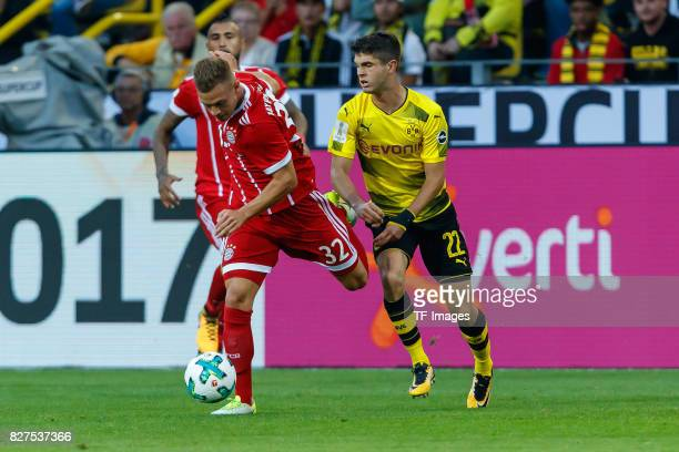 Joshua Kimmich of Bayern Muenchen and Christian Pulisic of Dortmund battle for the ball during the DFL Supercup 2017 match between Borussia Dortmund...