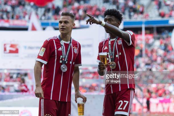 Joshua Kimmich of Bayern Muenchen and David Alaba of Bayern Muenchen celebrates with beer after the Bundesliga match between Bayern Muenchen and SC...