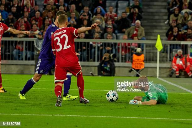 Joshua Kimmich of Bayern Muenchen and goalkeeper Matz Sels of Anderlecht battle for the ball during the UEFA Champions League group B match between...