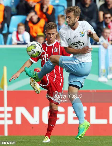 Joshua Kimmich of Bayern Muenchen and Jan Koch of Chemnitz battle for the ball during the DFB Cup first round match between Chemnitzer FC and FC...